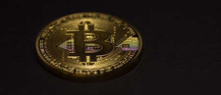 single golden valuable bitcoin on black background panorama view 写真素材