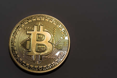 shiny single bitcoin on a black background detail view