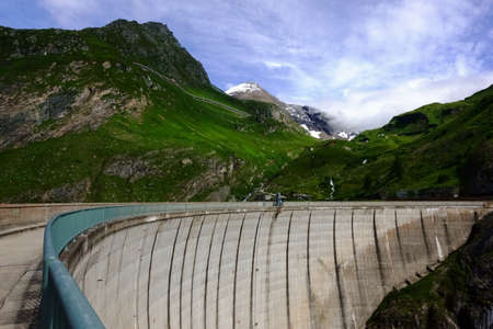 high wall from a hydroelectric power plant in the mountains of austria