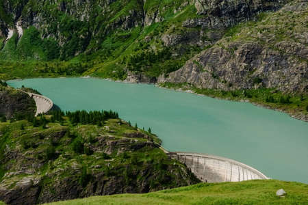 wonderful view to the green water from a hydroelectric power plant in austria