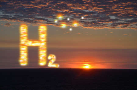 shining h2 hydrogen letters with a sunset and burning clouds at the sea