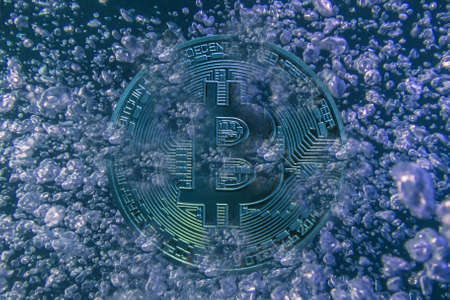 valueable blue bitcoin crypto currency with lot of air bubbles before bursting