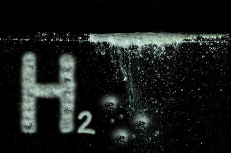 h2 hydrogen letters and many little white bubbles in black water