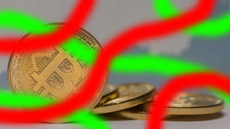 valueable bitcoin next to each other with red green stipes