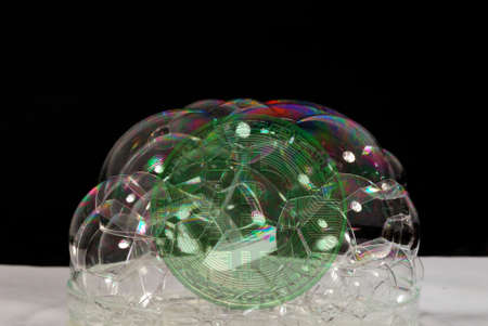 valueable green bitcoin crypto currency behind many soap bubbles Banque d'images