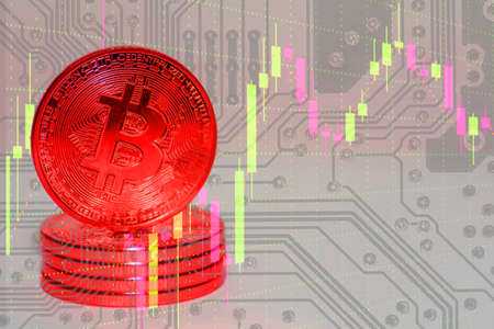 valueable red bitcoin stands on the top of other bitcoins with electrical circuit diagram and a chart