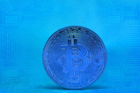 single blue bitcoin coin with blue electrical circuit diagram