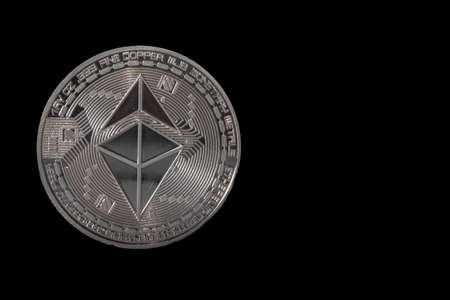 valueable silver shining ether from ethereum coin crypto currency with black background