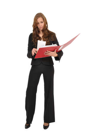 Business woman flips through a red folder