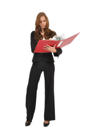 Clerk reads a page from a red folder Stock Photo - 9974822