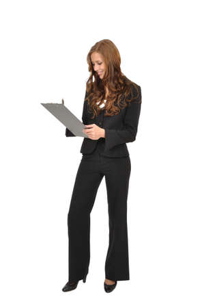Business woman with a clipboard taking notes Stock Photo - 9974828