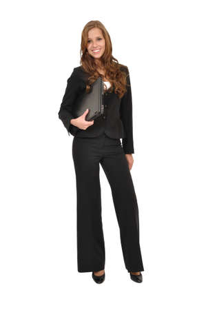 Young woman in suit with laptop Stock Photo