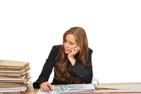 Business woman looks annoyed at the mountain of documents