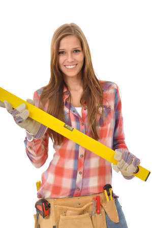 young woman with long hair holding a spirit level Stock Photo