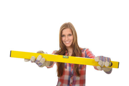 attractive young trainees with work gloves shows her spirit level