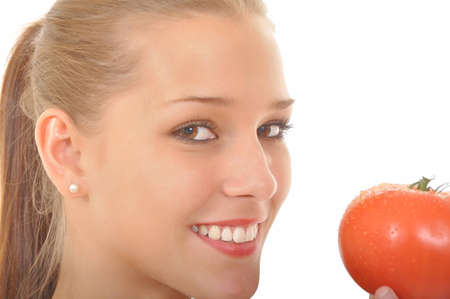 attractive young woman holding a red tomato