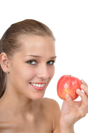 sexy young woman with green eyes holding an apple Stock Photo