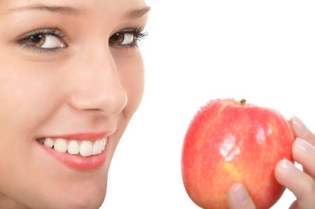 young woman with red apple and focus on background Stock Photo