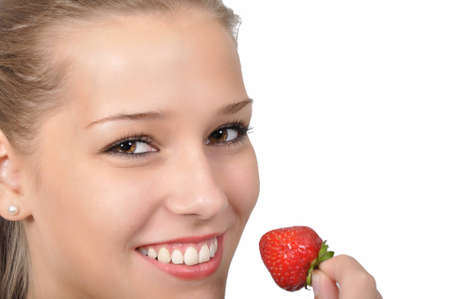 pretty young woman holding a red strawberry