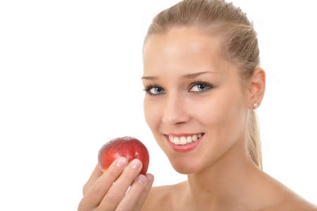 sexy young woman holding a red nectarine Stock Photo