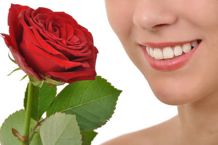 closeup of a smiling young woman with red rose