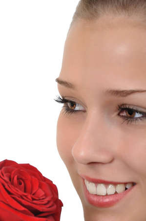 pretty young woman with brown eyes and a red rose looks dreamy Stock Photo