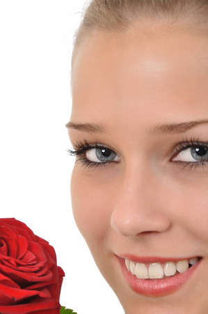 young woman with blue eyes and red roses looking at the camera Stock Photo