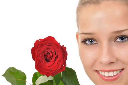 pretty face with blue eyes and a red rose Stock Photo