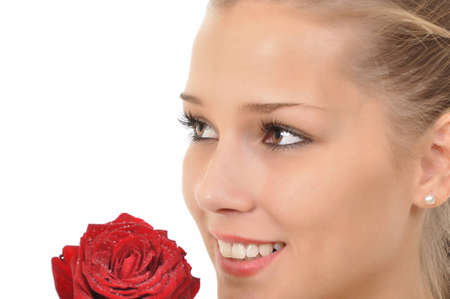 pretty young woman with a rose full of water drops Stock Photo