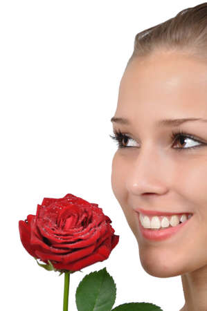 young woman is pleased with a red rose with water drops Stock Photo