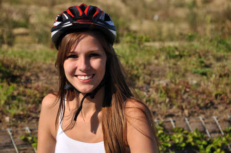 Smiling woman with a helmet  Stock Photo