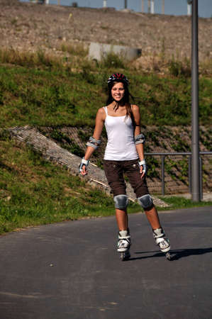 Model is inline-skating in the summer Stock Photo