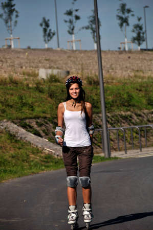 Girl is rollerblading with a helmet Stock Photo