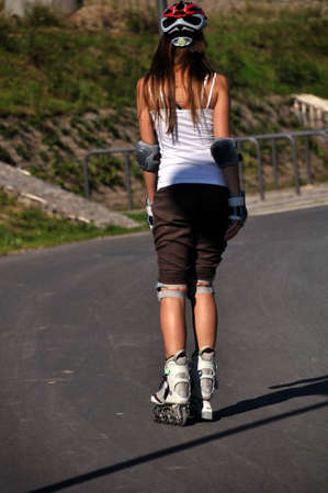 The back of a young skatergirl