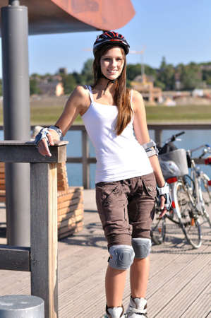 Girl is posing with her inline-skates for the camera Stock Photo