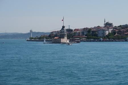 Maidens Tower - also known as Kizkulesi or Leandertower - in Istanbul, Turkey with Bosphorus Bridge