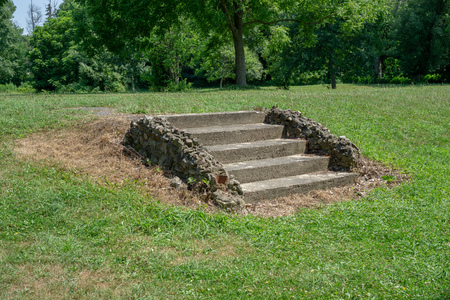 Stairs leading to nowhere in park Stock Photo