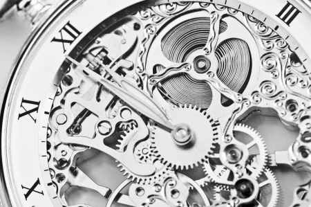 watchmaker: black and white close view of watch mechanism
