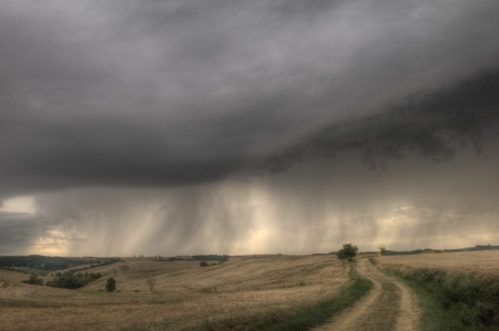 changing stormy weather on french countryon early evening photo
