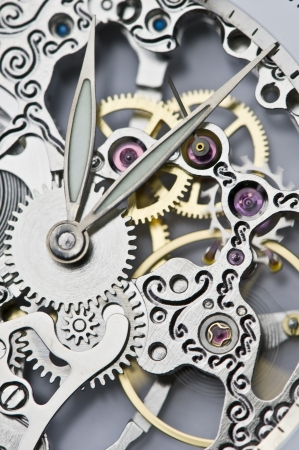 watchmaker: close view of watch hands and mechanism