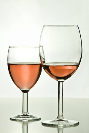 two rose wine glasses on a table Stock Photo - 17096958