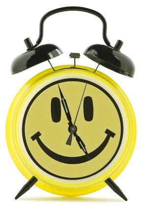 vintage smiley alarm clock indicates almost five  Imagens