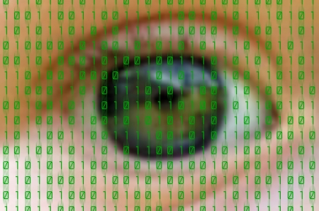 green binary numbers on human eye background