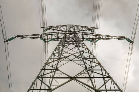 front geometrical view of a high voltage pylon cloudy sky background photo