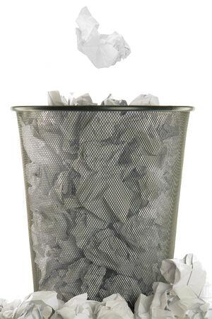 wastepaper: basket full of white wastepaper on white background