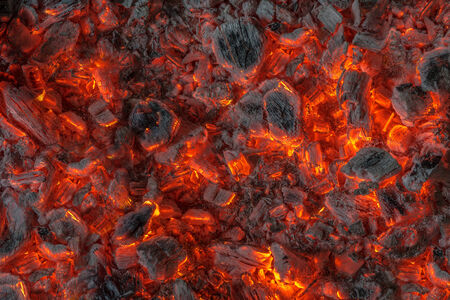 incandescent orange and red embers texture photo