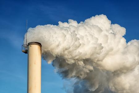 smokestack: factory chimney and smokestack on blue sky background