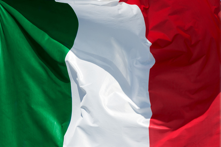 pleat: full framed italian flag floating in the wind exact colors Stock Photo