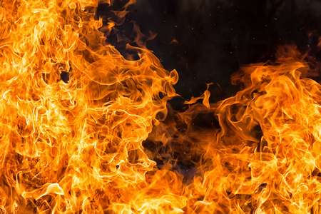 intense orange fire flames textureon black background