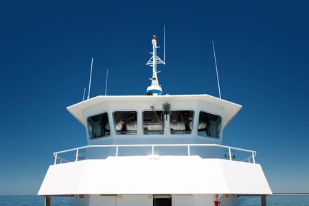 front view of  the navigation cabine on a passenger ship on blue sky background Stock Photo
